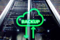 Backup button on modern server room background. Data loss prevention. System recovery.  royalty free stock photography