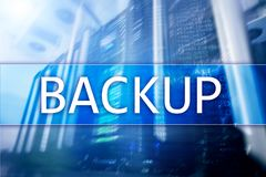 Backup button on modern server room background. Data loss prevention. System recovery.  stock photography