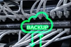 Backup button on modern server room background. Data loss prevention. System recovery.  stock images