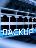 Backup button on modern server room background. Data loss prevention. System recovery.  royalty free stock photo