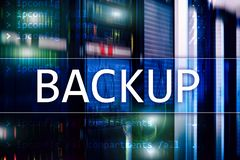 Backup button on modern server room background. Data loss prevention. System recovery.  stock photos