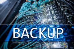 Backup button on modern server room background. Data loss prevention. System recovery.  royalty free stock photos