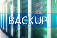 Backup button on modern server room background. Data loss prevention. System recovery.  stock photo