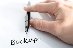 Backup concept. Pen in the hand  over white background Backup concept Stock Image