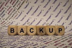 Backup - cube with letters and words from the computer, software, internet categories, wooden cubes stock image