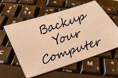 Backup il vostro concetto del testo del computer fotografia stock libera da diritti