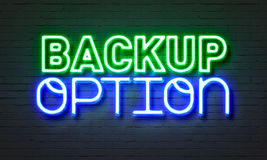 Backup option neon sign on brick wall background. Backup option neon sign on brick wall background royalty free stock images