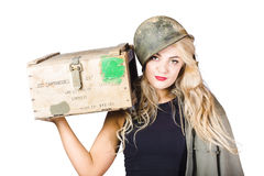 Backup pinup girl wearing army helmet and supplies Stock Image