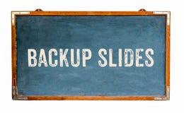 """""""Backup Slides†文本在一个宽蓝色老脏的葡萄酒木黑板或减速火箭的黑板写的词消息 免版税库存照片"""