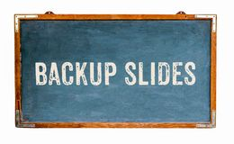 """Backup Slides"" text word message written on a wide blue old grungy vintage wooden chalkboard or retro blackboard. With frame isolated on white royalty free stock photos"