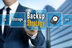 Backup Strategy touchscreen is operated by a businessman.  Stock Photo