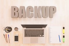 Backup text concept. Backup - text concept with notebook computer, smartphone, notebook and pens on wooden desktop. 3D render illustration Stock Image