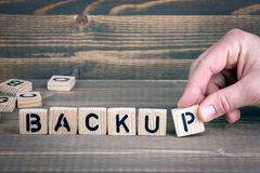 Backup. Wooden letters on the office desk, informative and communication background stock image