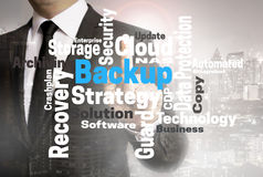 Backup wordcloud touchscreen is shown by businessman.  stock photos