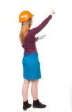 Backview бизнес-леди в шлеме конструкции с таблеткой p Стоковая Фотография