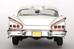 Backview 1958 del coche del juguete de la escala del metal de Chevrolet Impala Imágenes de archivo libres de regalías