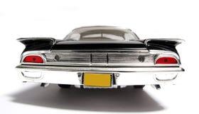 Backview 1960 del fisheye dell'automobile del giocattolo della scala del metallo del Ford Starliner Fotografia Stock