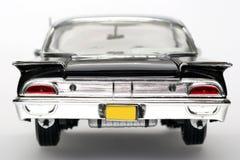 Backview 1960 dell'automobile del giocattolo della scala del metallo del Ford Starliner Fotografia Stock