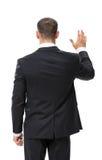 Backview av den vinkande handen för affärsman arkivfoto