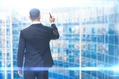 Backview biznesmena writing na wirtualnym ekranie fotografia royalty free