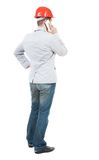 Backview of business man in construction helmet stands and enjoy Stock Photography