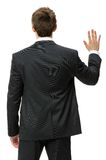 Backview of business man waving hand Royalty Free Stock Photos