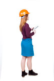 Backview of business woman in construction helmet stands and enj Stock Images