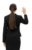 Backview of business woman waving hand Stock Image
