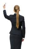 Backview da escrita da mulher de negócios na tela fotos de stock