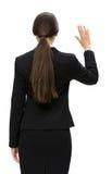 Backview da mão de ondulação da mulher de negócio imagem de stock