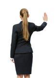 Backview da mão de ondulação da mulher de negócios fotos de stock royalty free