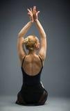 Backview of dancing on the wooden floor ballet dancer royalty free stock images