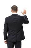 Backview der wellenartig bewegenden Hand des Geschäftsmannes stockfoto