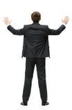 Backview des Geschäftsmannes mit den Händen oben stockfotos