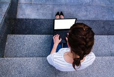 girl with notebook sitting on the gray steps stock photography
