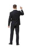 Backview intégral d'homme d'affaires avec le marqueur Photographie stock libre de droits