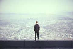 Backview of man on rooftop royalty free stock photography