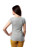 Backview portrait of a young woman standing Stock Images