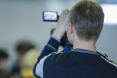 Backview of Professional Cameraman Filming Using Professional Vi Royalty Free Stock Image