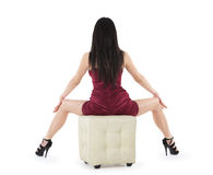 Backview of sitting sexy woman in red dress Royalty Free Stock Photos