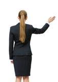 Backview van vrouwelijke manager golvende hand royalty-vrije stock afbeeldingen
