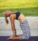 Backwards bend yoga pose. Woman in a back bend yoga pose in the park Royalty Free Stock Photos