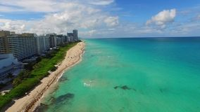 Backwards flight aerial video Miami Beach FL. Aerial video of Miami Beach in the summer 4k stock video footage
