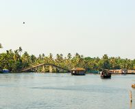 Backwater Canals with a Bridge and Houseboats, Kerala, India. This is a photograph of backwater canals with a bridge and houseboats, captured in Kerala, India stock images