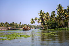 Backwaters. House boats in the backwaters Kerala over blue sky stock photos