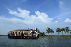 Backwaters of Kerala. A houseboat cruises on the backwaters of Kerala, India Royalty Free Stock Photography
