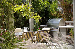 Backyard. A relaxing backyard view on a sunny day wanting to be used Royalty Free Stock Image