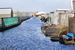 Agriculture industry along a canal in Boskoop Stock Photography