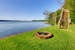 Backyard area with wonderful water view and fire pit. Stock Images