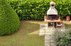 Backyard barbecue. Backyard masonry fireplace for barbecue stock photography
